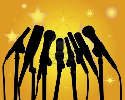 7821765-black-silhouettes-of-microphones-on-an-orange-background