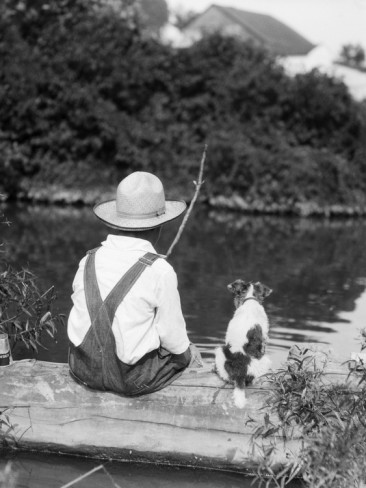 h-armstrong-roberts-1920s-1930s-farm-boy-wearing-straw-hat-and-overalls-sitting-on-log-with-spotted-dog-fishing-in-pond