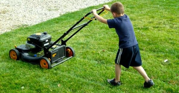 Boy mowing lawn